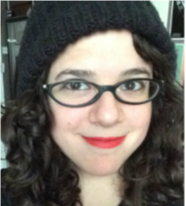 A photo of Lauren, a copywriter. She has curly hair and glasses, and is wearing lipstick.